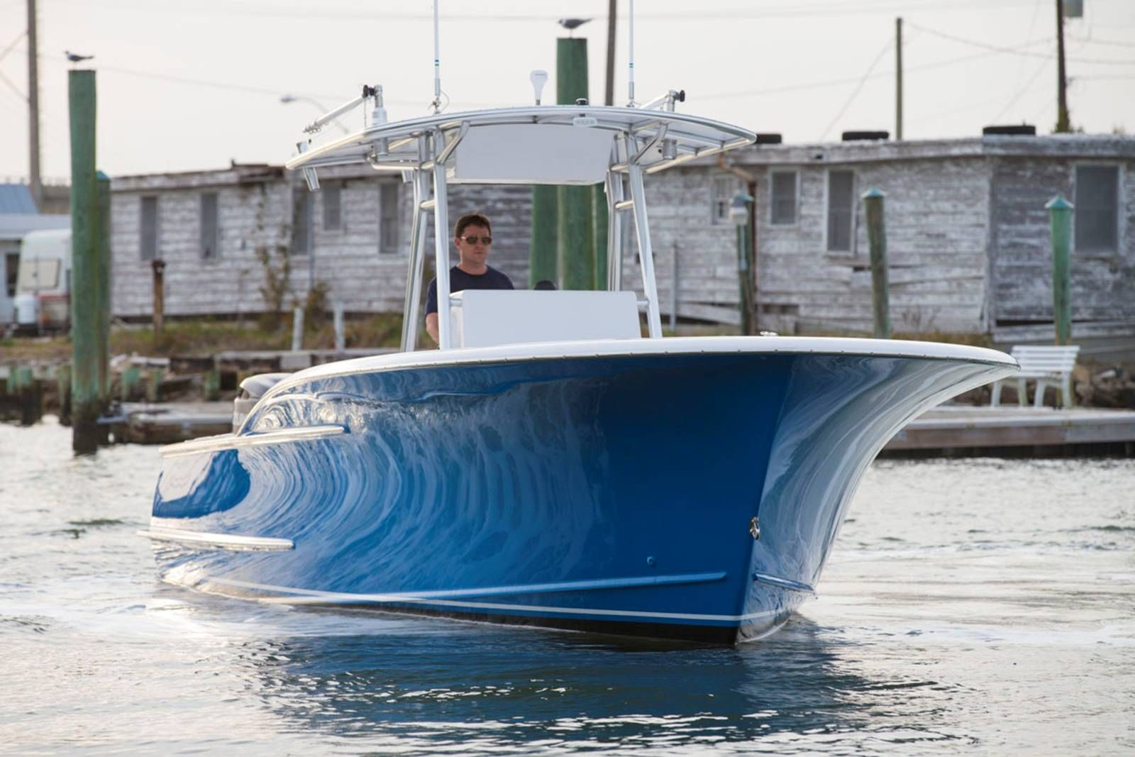 Serious flare on this stunning blue hull center console.