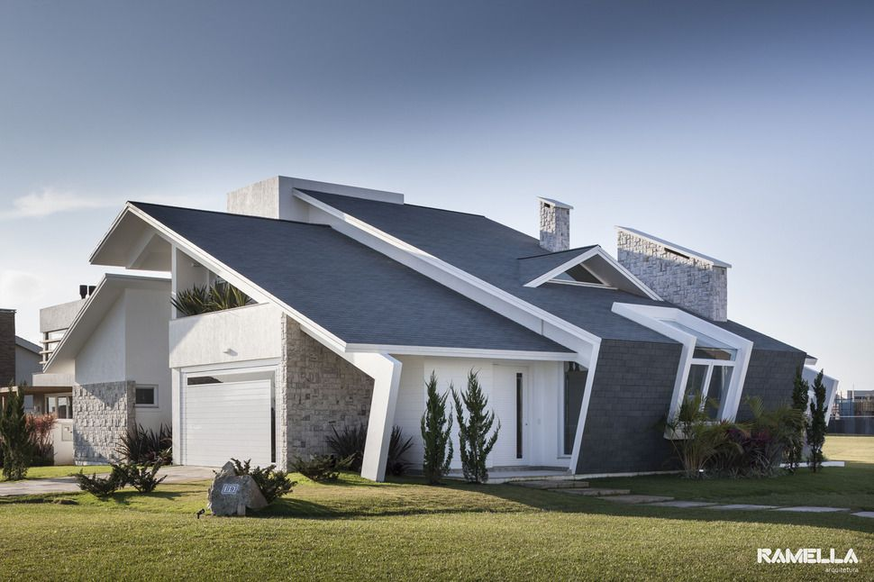 Pitched roofline on house morphs into angled facade Architecture home facade