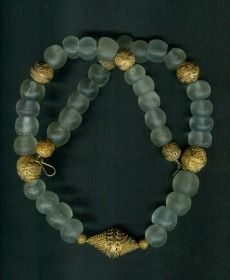 Necklace made with glass beads from the Islamic glassmaking period, 900 to 1200 AD. Center of glass making was Fustat in Egypt (today's Cairo) . The large beads are very rare