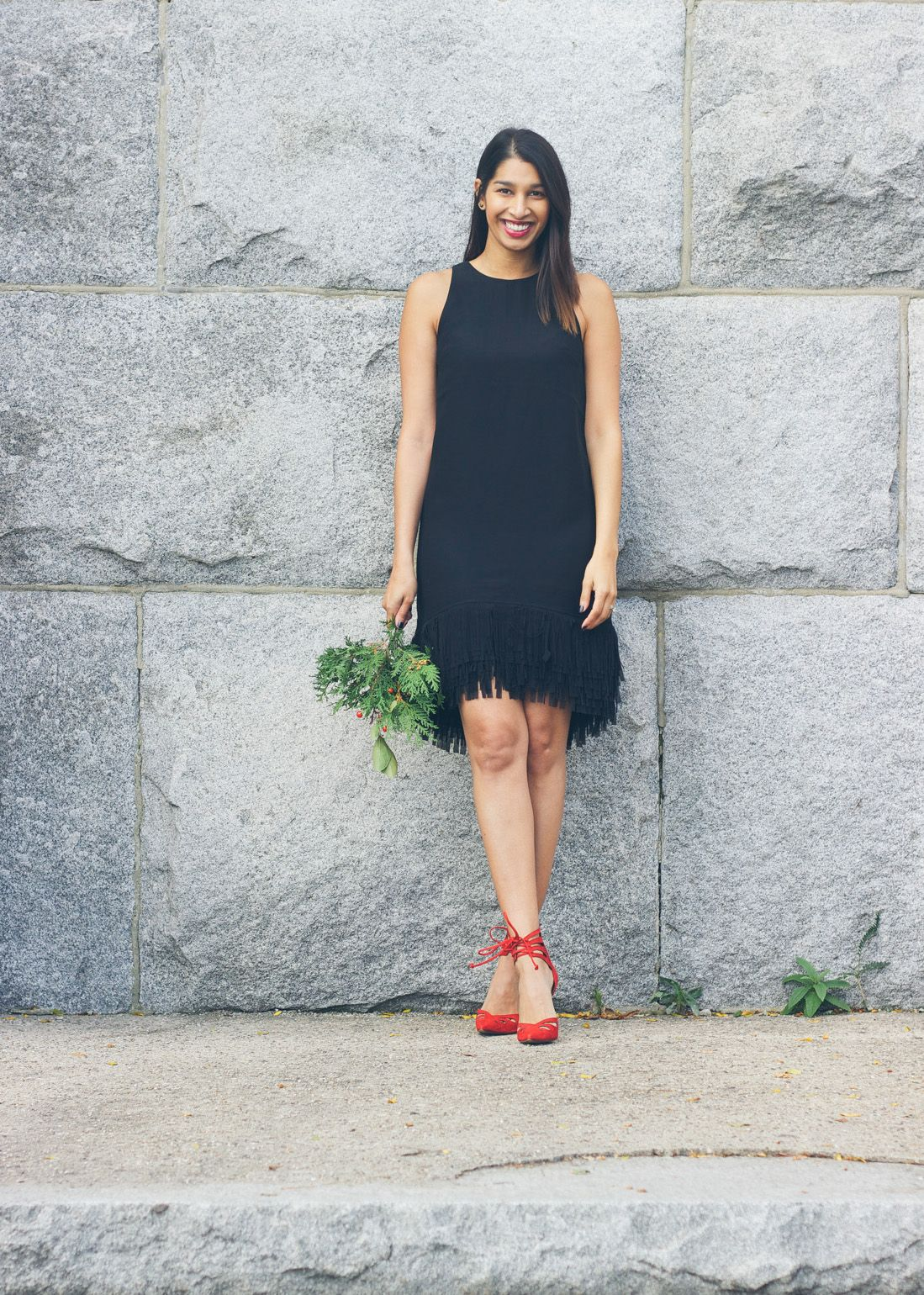 Lows to Luxe styles our black fringe-hem dress with standout red ...