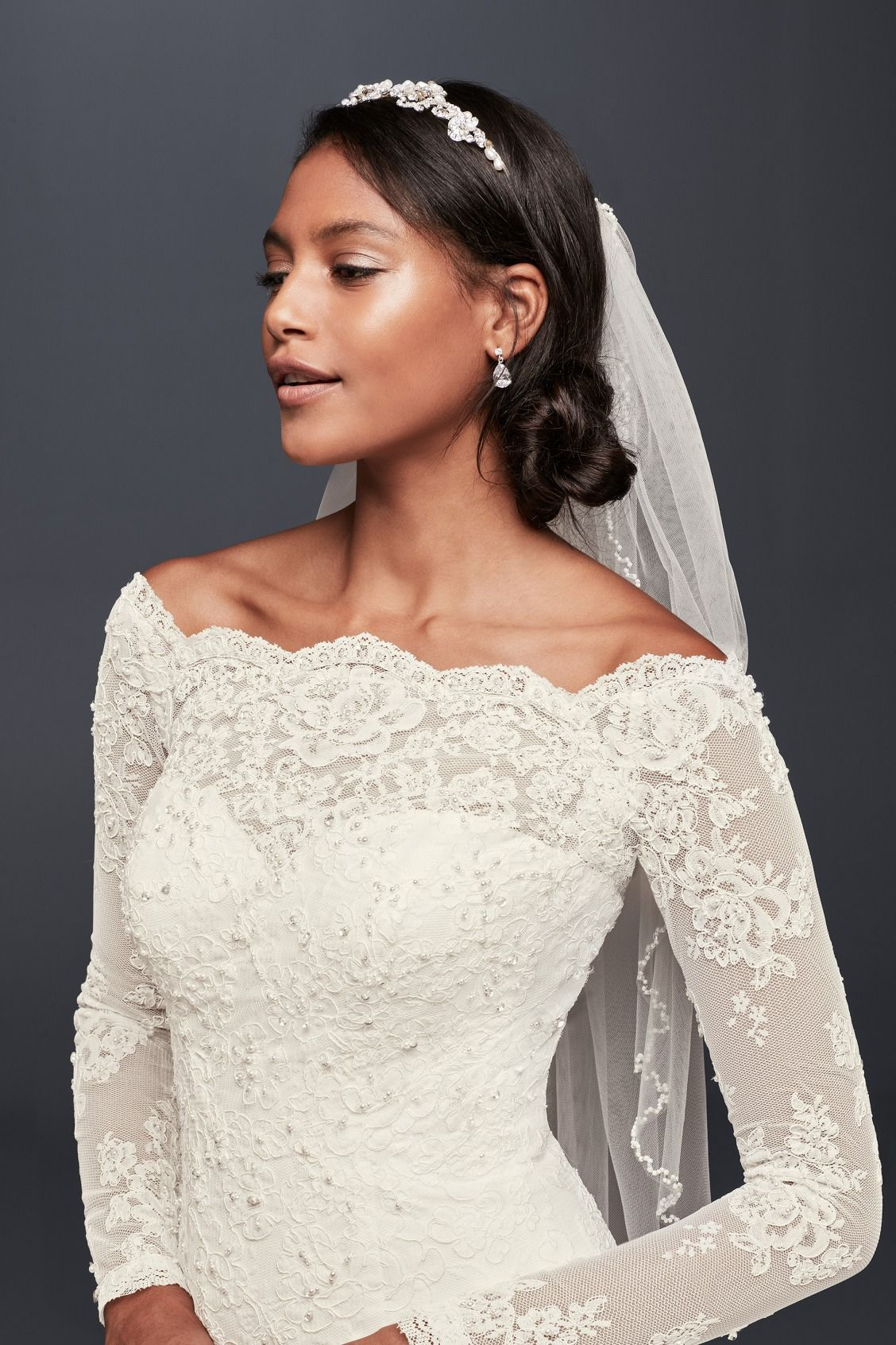 A timeless bridal look a low twisted bun midlength veil
