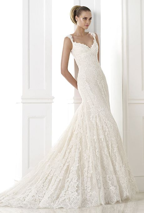 Brides: Pronovias. Dress with sheer layers of guipure and lace on body and skirt. Sweetheart bodice with lightly gathered straps. Sheer and deep plunging back.