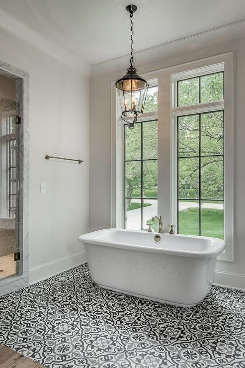 Black And White Mediterranean Bathroom Features A Lantern Hanging Over A  Freestanding Tub Fitted With A