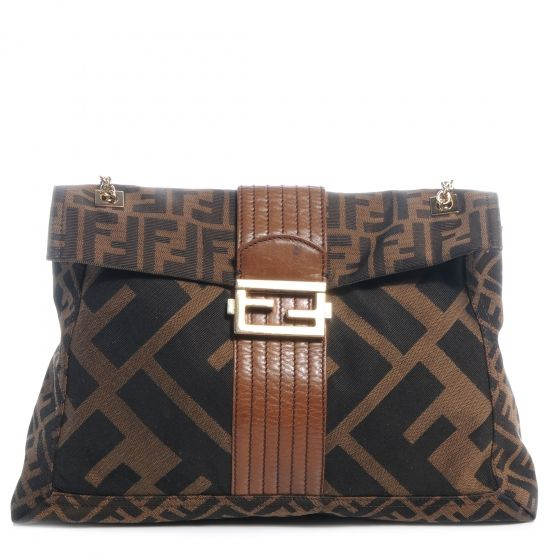 77561d5a1f48 This is an authentic FENDI Zucca Maxi Baguette Tobacco. This stylish  baguette is crafted of oversized Fendi FF Zucca canvas.
