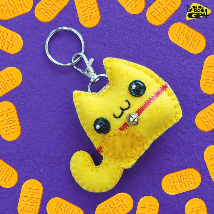 """Need a bit of extra luck? Why not make it cute while you're at it with a Kawaii Yellow Maneki Neko Cat Plush Keychain & Bag Charm! Whether you're a cat lover, a kawaii lover, or a bit of both, these handmade lucky cat charms are here to put a smile on your face. Meaning """"beckoning cat,"""" maneki neko are common figurines from Japan that are believed to bring good luck. The colors of the cats have different meanings as well. Yellow maneki neko are supposed to attract wealth and prosperity."""