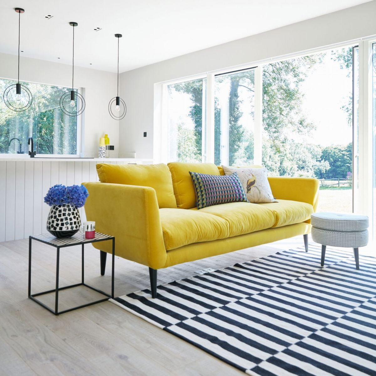 canaray yellow velvet sofa adds a pop of colour to an all grey