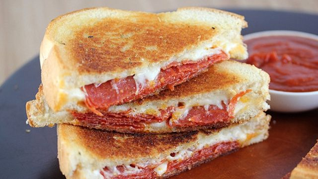 Pizza grilled cheese sandwich. I always make these on the george foreman grill. thanks to my HS foods teacher for this idea