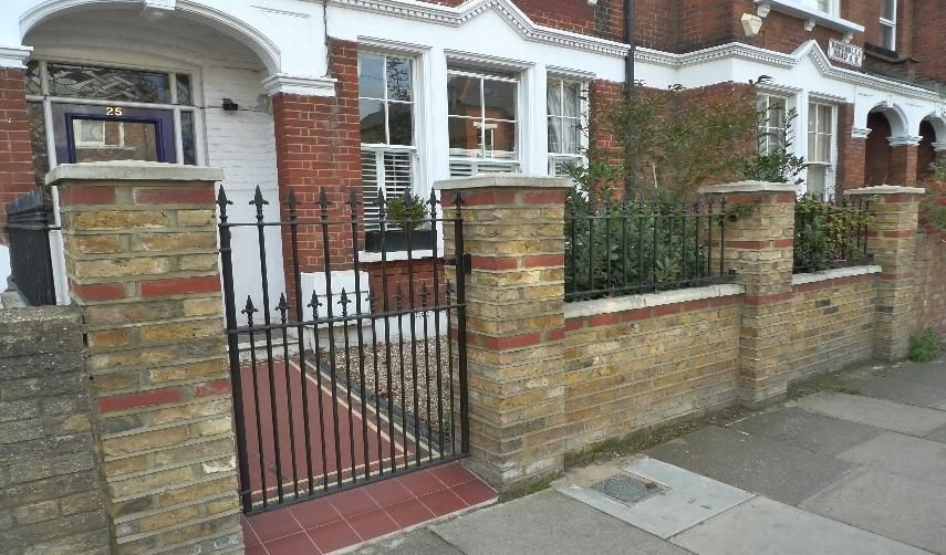 Kensington brick wall landscape gardeners and designers for Front garden brick wall ideas