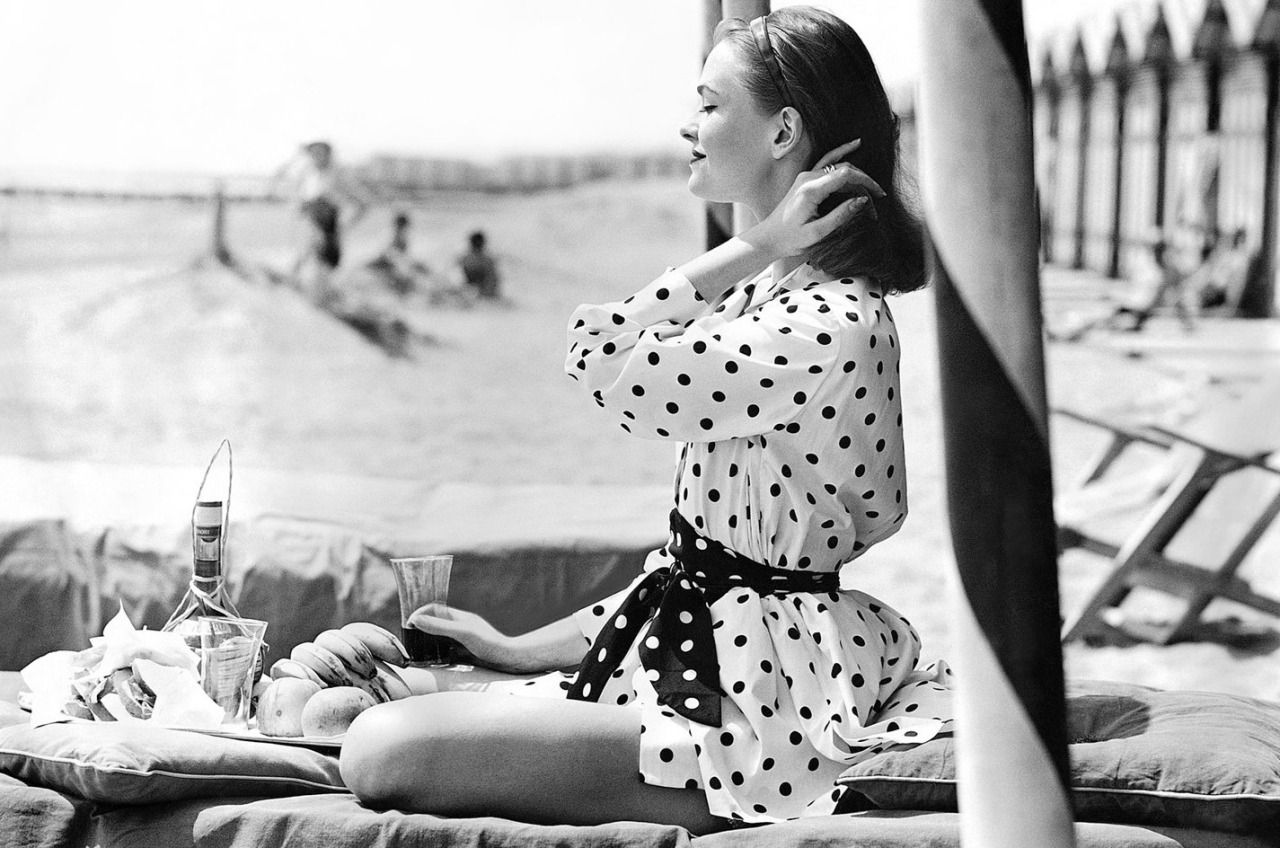 """Polka dots on the beach"" - Susan Abraham photographed by Henry Clarke for Vogue, 1956."