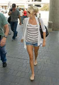 Denim shorts, striped tank, and an open cotton cardigan.
