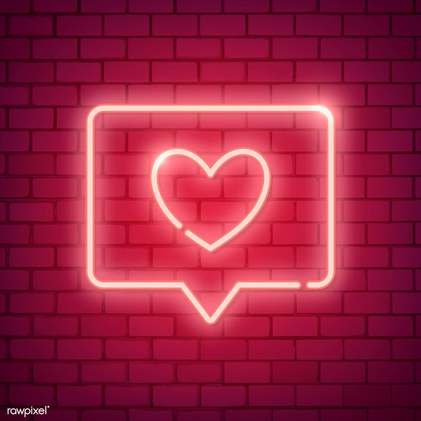 Neon light Valentine's day symbol on brick wall free