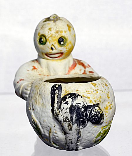 pumpkin head German bisque Halloween candy holder. Click on the image for more information.
