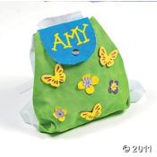 party favor bags - backpacks will be purple for girls and orange for boys