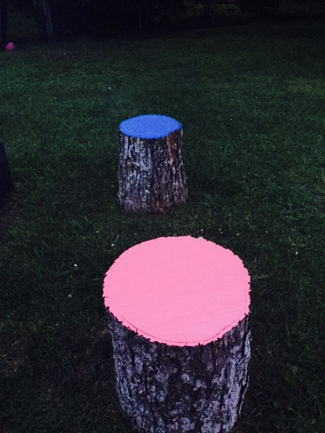 Finally getting around to painting the stump seats around the fire pit.