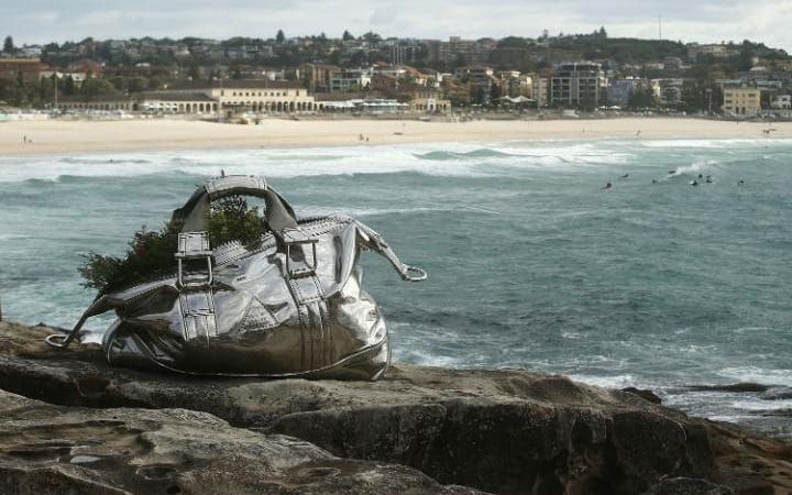 A sculpture titled 'Travelling Bag' is seen at Sculpture By The Sea at Bondi Beach in Sydney, Australia