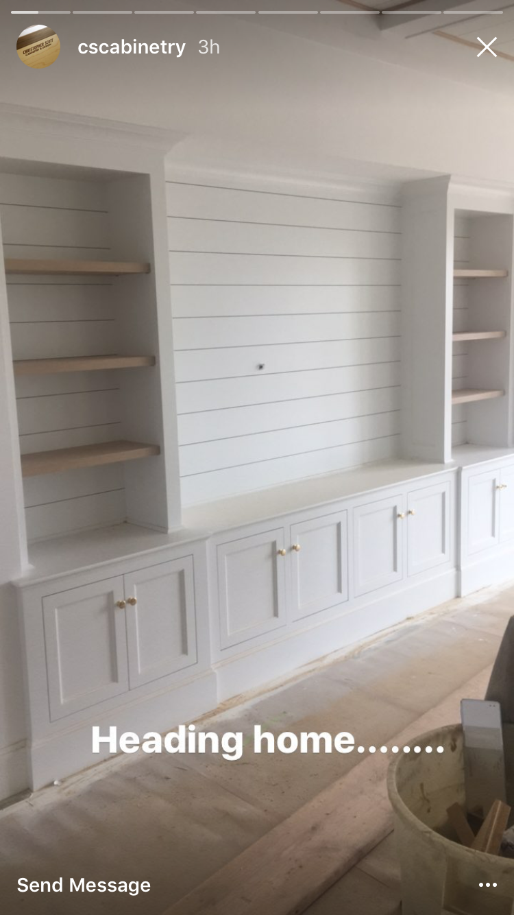 Shiplap bookshelves next to the fireplace in living room