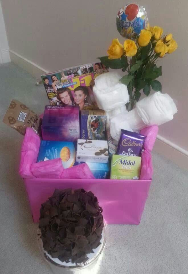 "The ""Welcome to Womanhood"" basket. Full of chocolate, midol, pads and other gifts for your daughter who just got their... ""friend"""