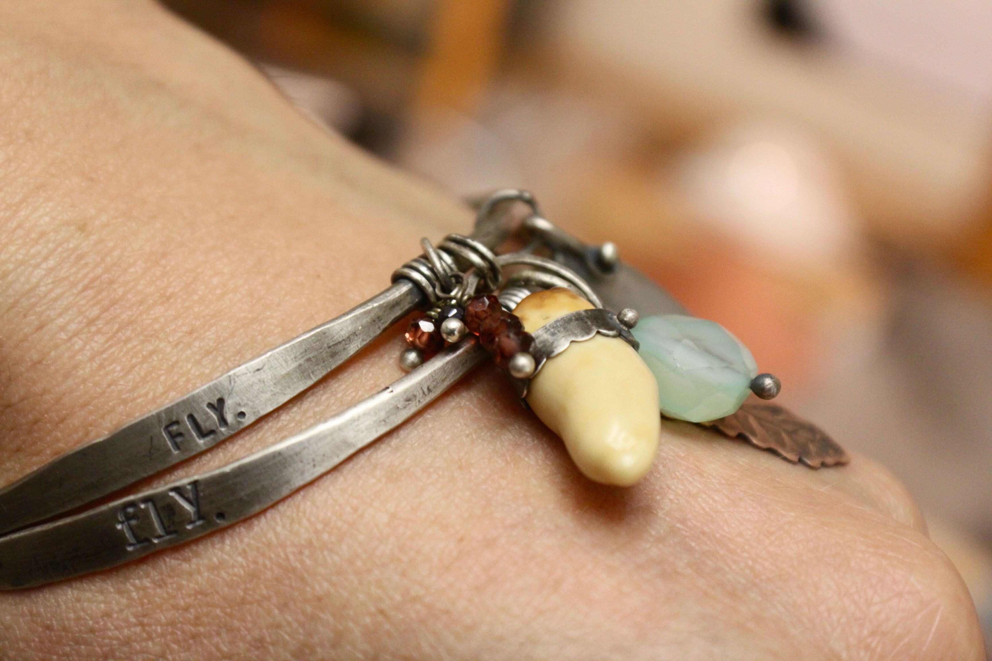 """""""fly"""" bangles.   Stacked silver with dangling goodies.  handmade by Ashly Weber  www.ashleyweber.com"""