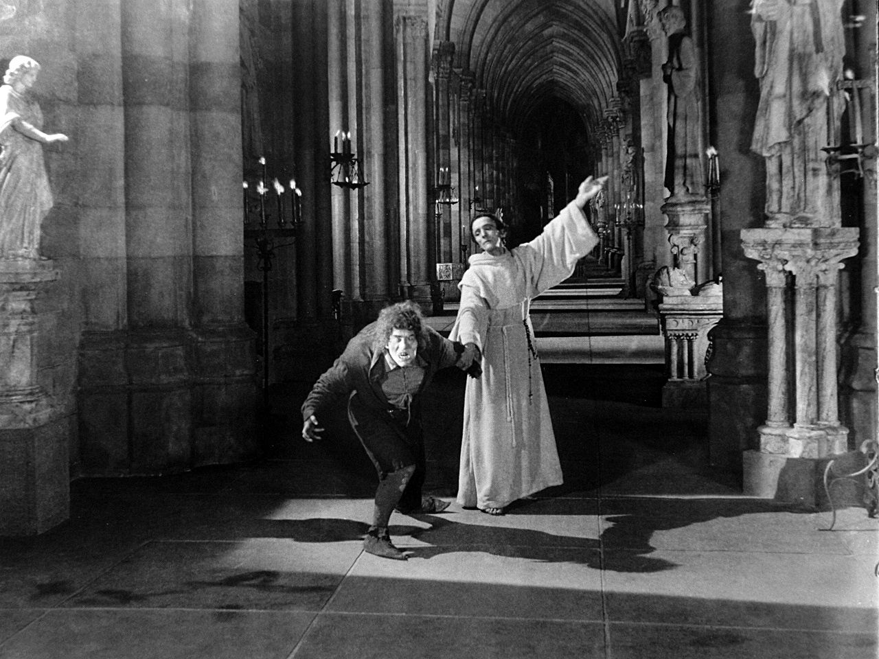 Hunchback -Notre Dame 1923 Claude Frollo restrains Quasimodo from ...