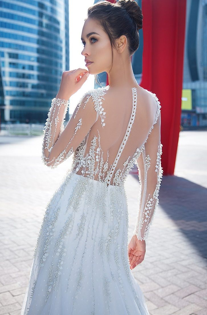 Long sleeves Dotted airy tulle skirt and sparkling rivers of pearls and 3d flowers applique fit and flare wedding dress chapel train #wedding #weddings #bridedress #bride #weddinggown