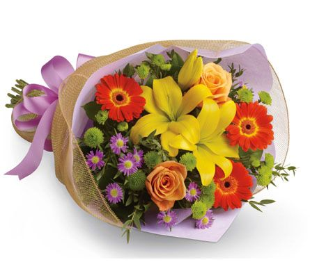 B27 Bright Lights. A burst of brilliant flowers designed to make their spirits soar! This spectacularly colourful bouquet includes lilies, gerberas and roses.