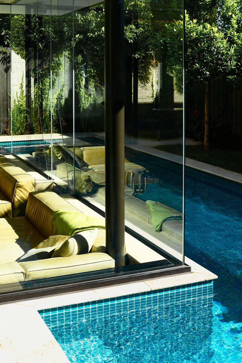 Cool Sunken Living Room Ideas For Your Dreamed House: This Sunken Lounge Is At Eye Level With The Swimming Pool, Making It A Great Space To Relax