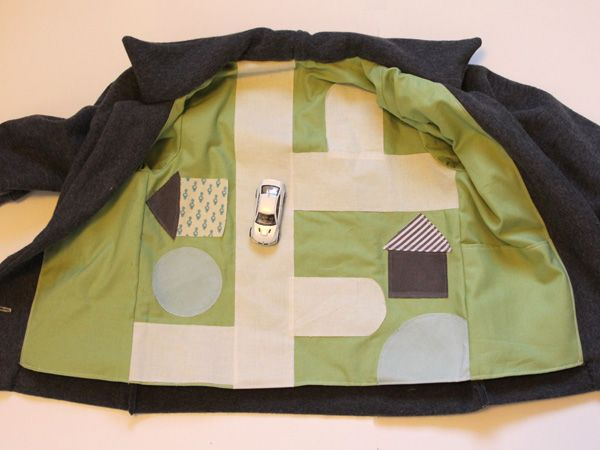 Not that I have kids or sewing skills, but this is clever!  Car playmat lining inside child's coat
