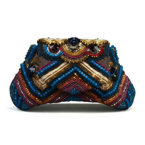 Bea Valdes Uzume Clutch. Hand-made in the Phillippines with faceted crystals, beads, sequins, and a swirl of tones such as pink and blue.