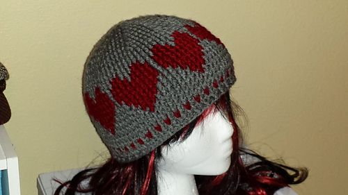 This cute crochet hat with hearts going around is made using a new ...