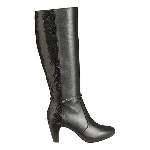 """Love the Parnella? Our favorite pump has been made available in this tall boot for this Fall Season. This Anti-Gravity style is lightweight and has a flexible outsole that offers comfort and traction. It features a side zipper for easy closure. Snake print detail along the back and ankle belted detail make this a gorgeous dress boot to add to your collection!  A 3"""" heel sits on a 1/2"""" base (equivalent to a 2 1/2 inch heel). Click on video icon above to see more!"""
