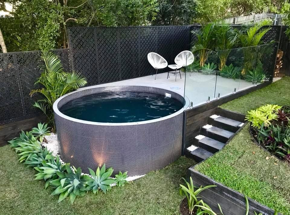 Semi Inground Rectangular Pool Surrounded By Concrete Stone Or Marble Small Backyard Pools Pools Backyard Inground Pool Landscaping