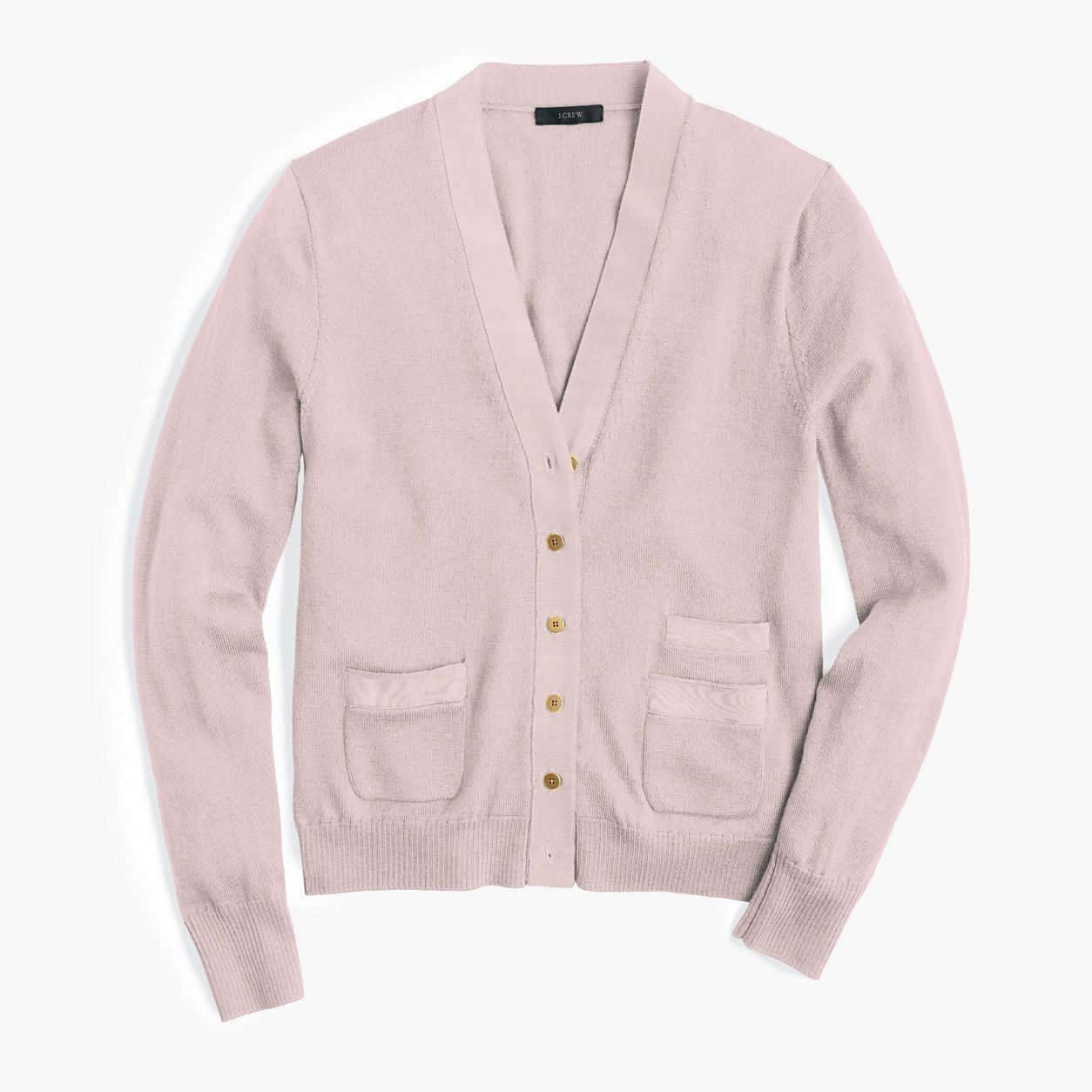 A classic cardigan sweater with double pockets and polished ...