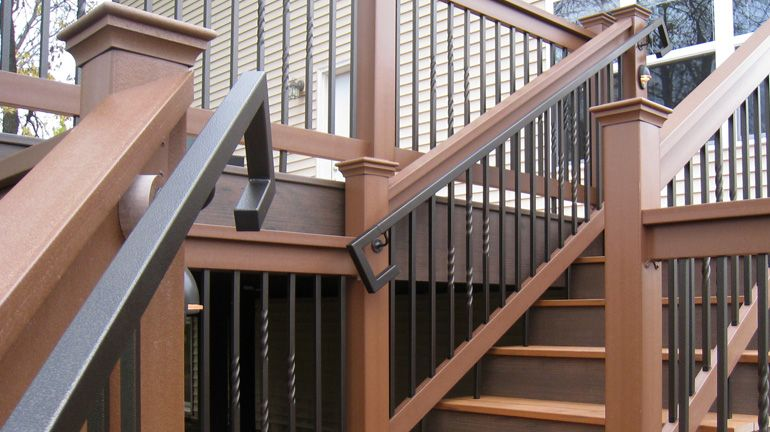 A Brown Composite Deck And Railing Is Equipped With Fortress Square Handrail And Handrail Returns In Antique Bronze Diy Deck Building A Deck Metal Deck