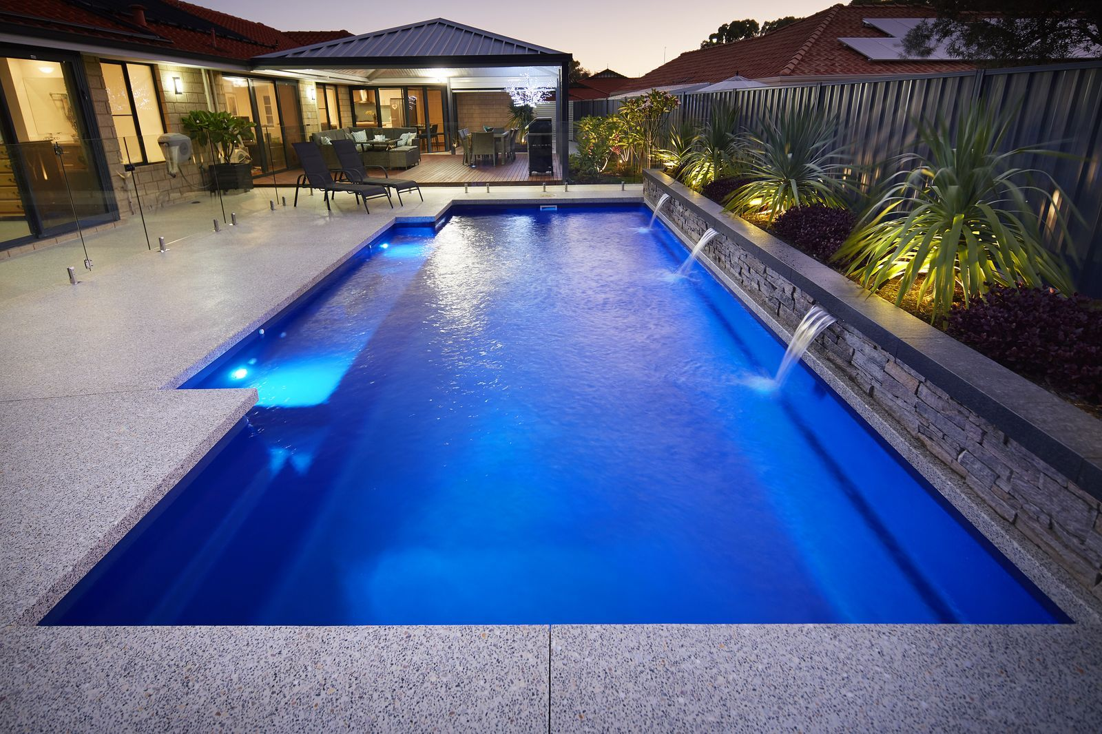 Decorative Concrete Pool Surrounds Options Add Value With Liquid Limestone And Exposed Aggregate Floor Swimming Pool Landscaping Concrete Pool Pool Renovation