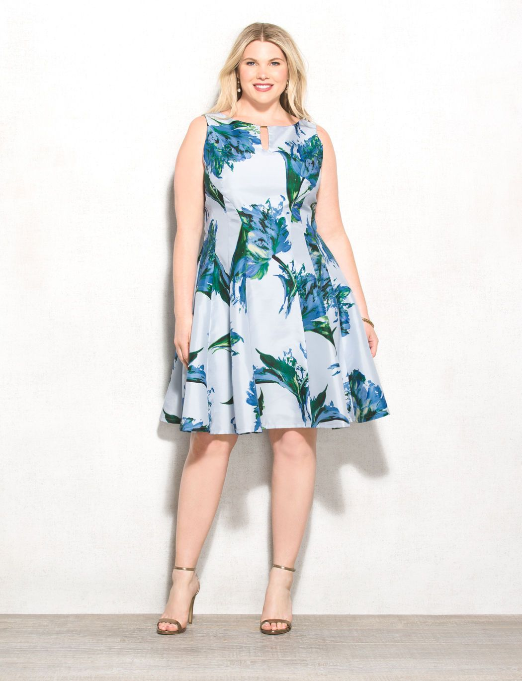 b510bde9721d One floral dress that's sure to impress. Flaunt this fancy fit-and-flare  style to your next party with metallic shoes and a bold lip.