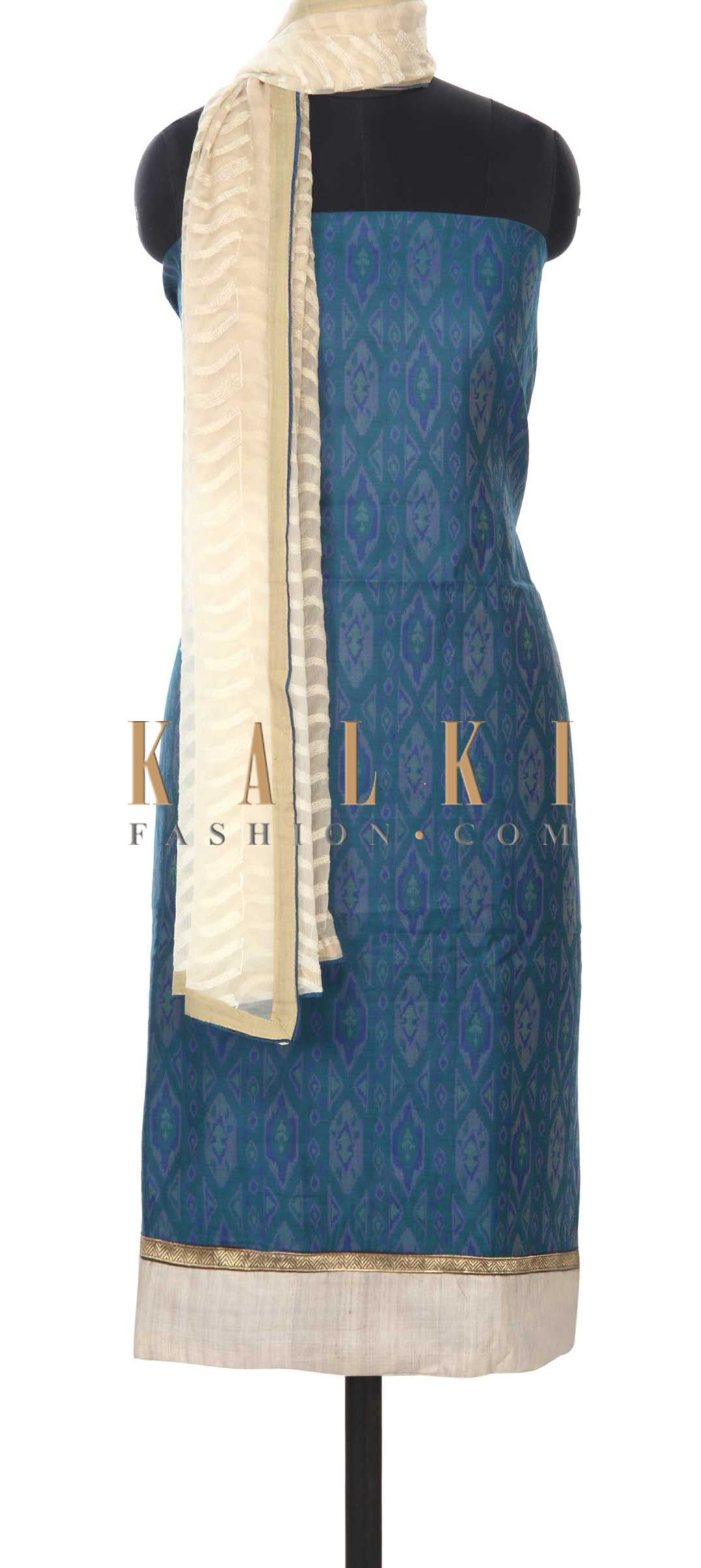 Buy this Blue unstitched suit enhanced in ikkat weave only on Kalki