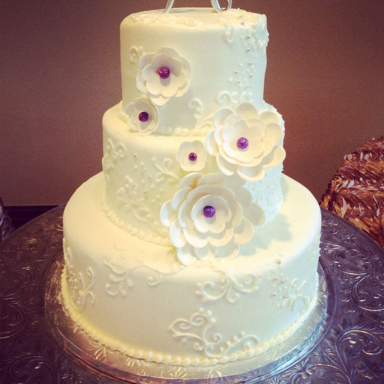 This 3 tier round cake has a custom piping on all tiers with multi ...