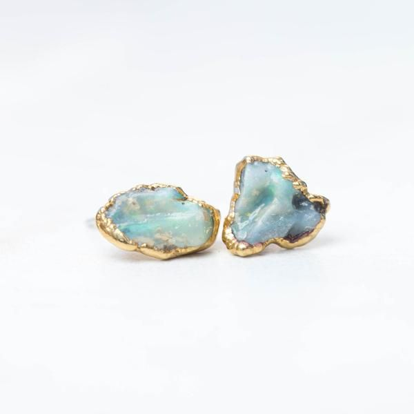 A Raw Opal Earring Stud Set With Pee Textured Bezel These Rough Earrings Are Tumble Polished And Complemented Setting Around The