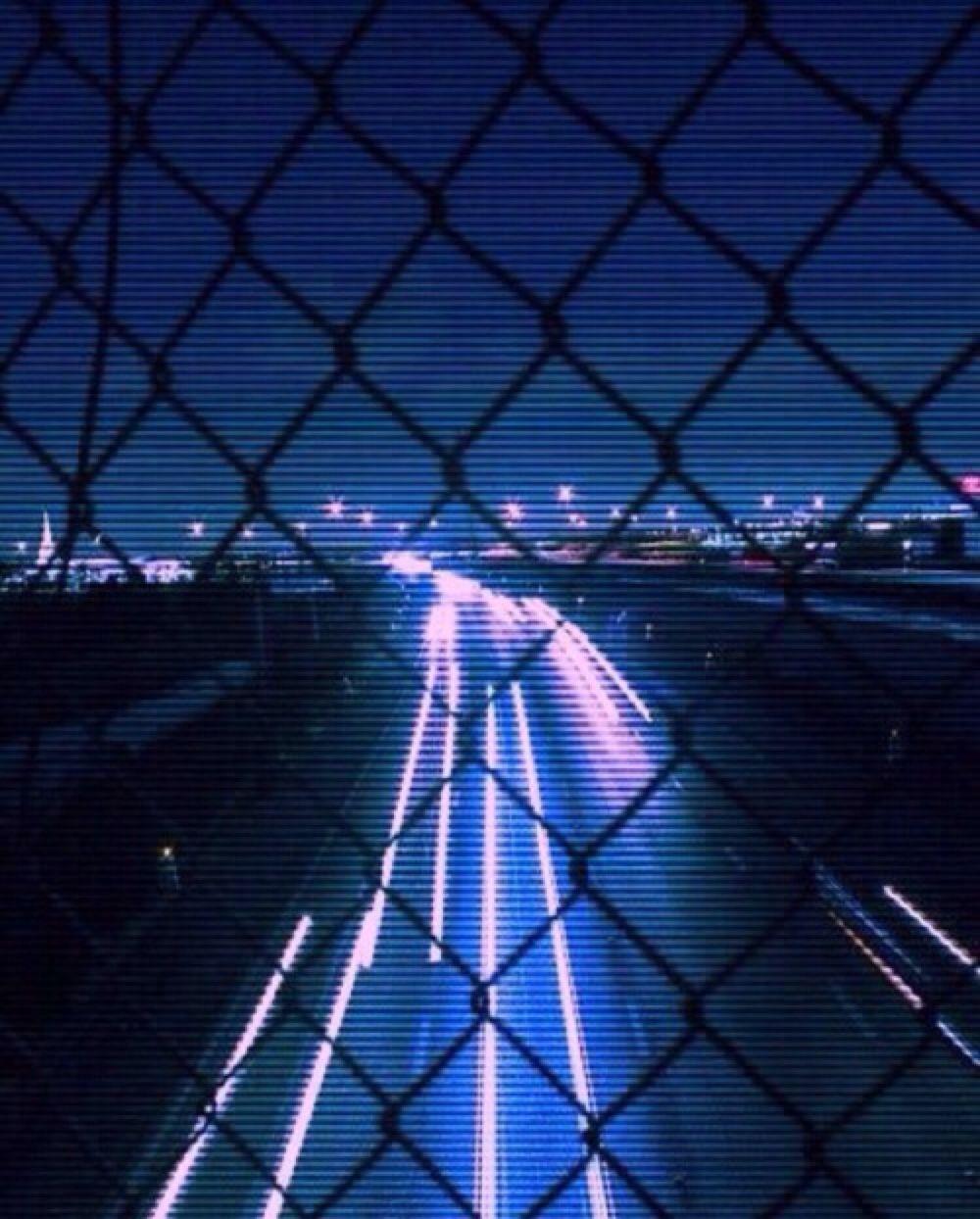 neon blue blur drive aesthetic road lit fence lights city