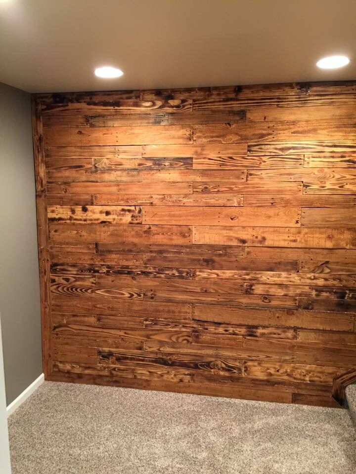 Slat Wall Made Out Of Pallets Burned Stained And Nailed To 1x4s