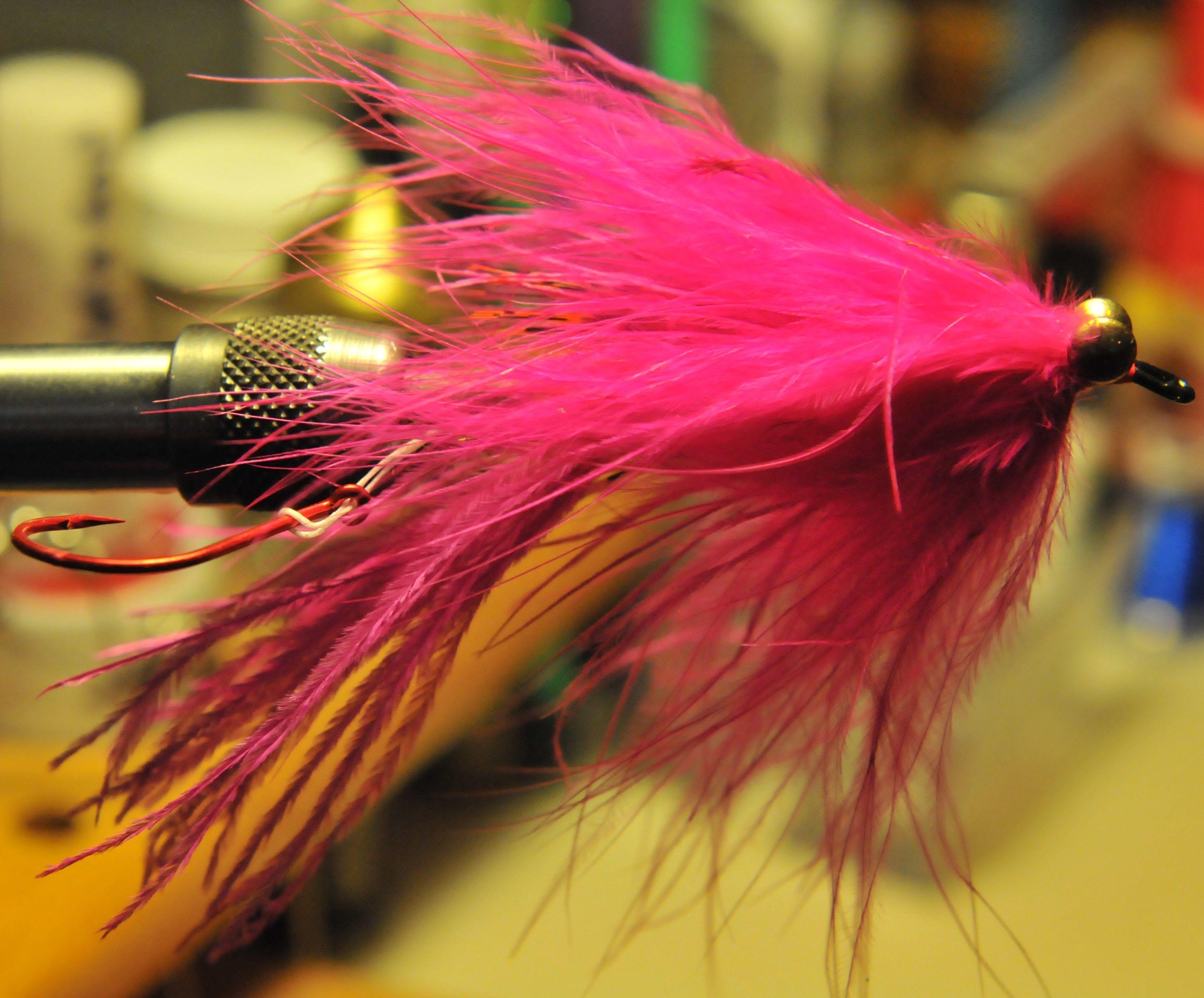 Fly Tying. A pink/cerise guide intruder. A Scott Howell pattern.