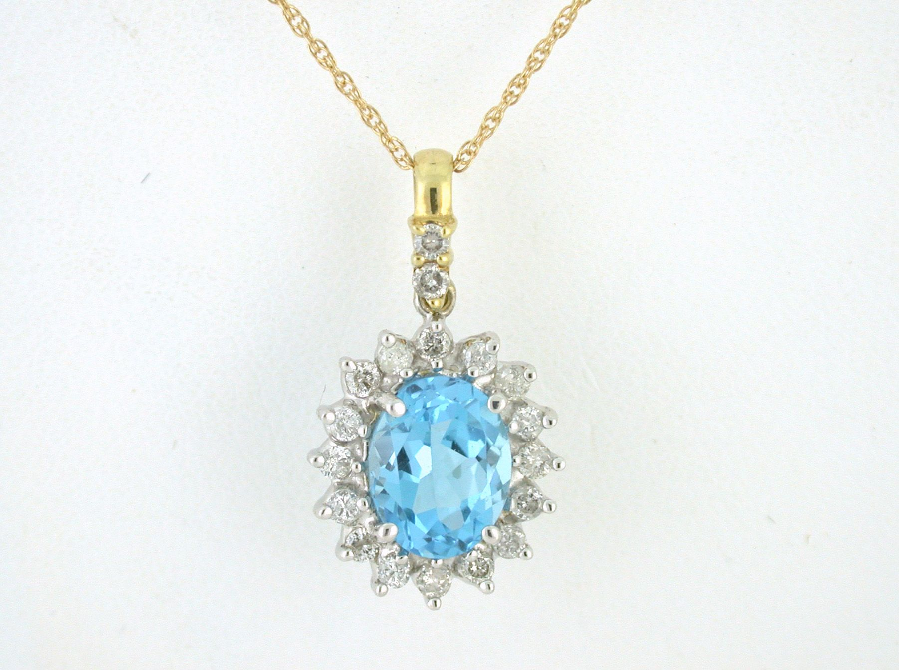 This stunning Swiss blue topaz is accented with .34 total carat weight of diamonds in a 10K pendant. Imagine how lovely it would be around your neck.   Visit www.sharpfacetsgallery.com to see even more choices in topaz as well as many other beautiful gemstones.