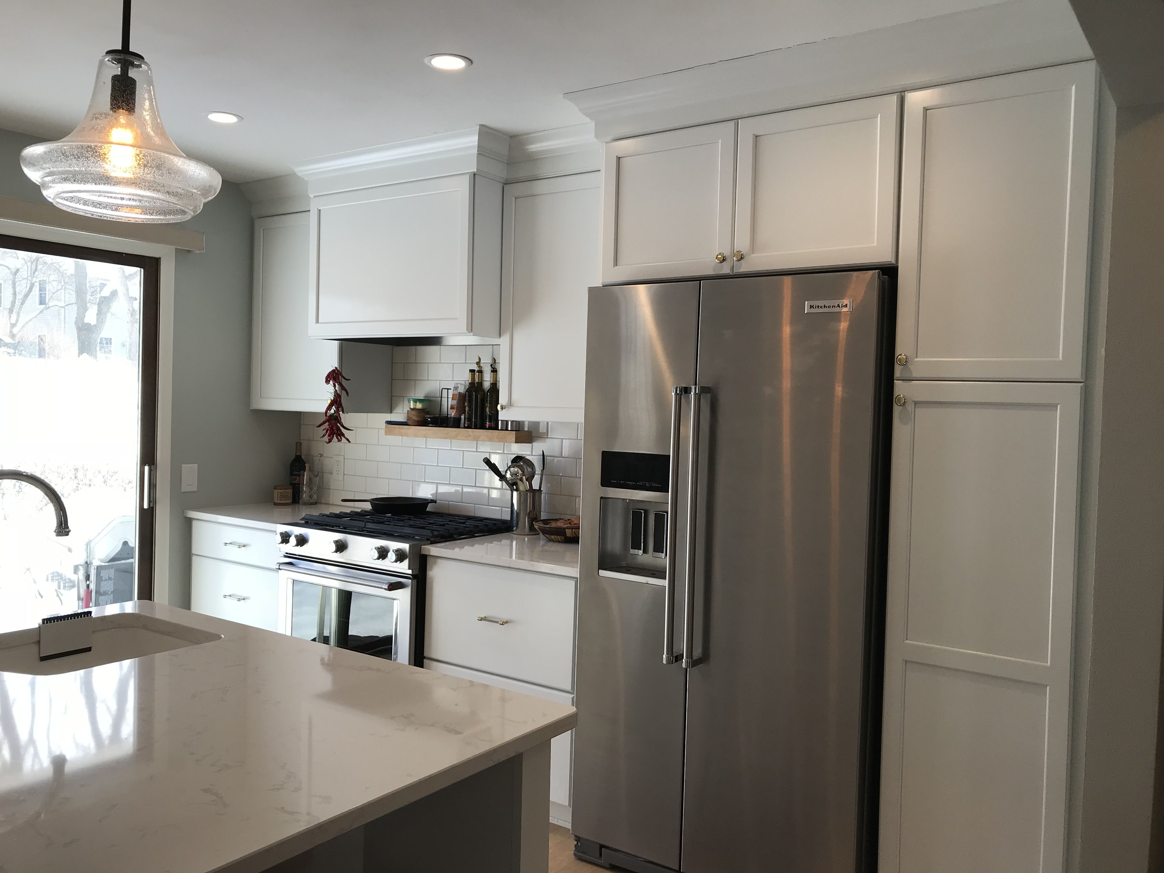 Contemporary White Cabinets With Crown Molding That Continues The
