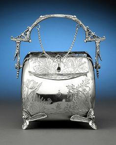 A wonderful English silver plate biscuit box