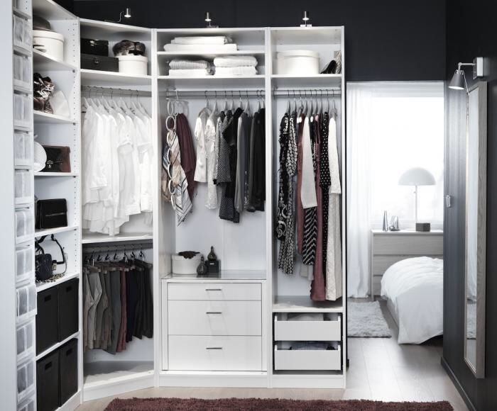 The Ikea Pax Wardrobe System being used without doors to create a