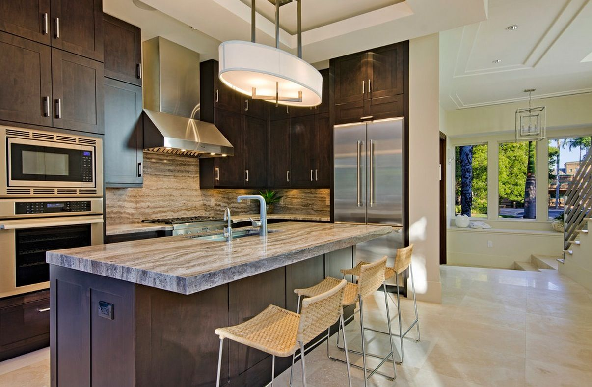 Luxurious kitchen with dark brown cabinets and decorated with