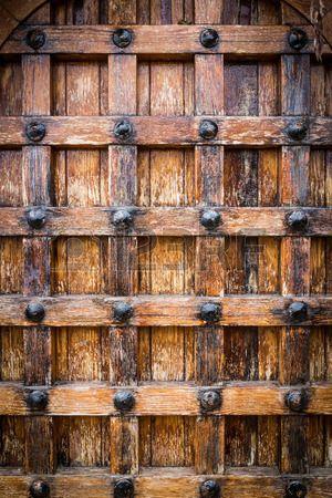 Photo of Heavy wooden door.