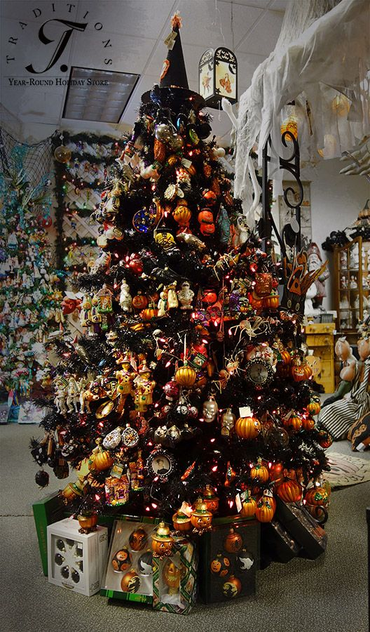 A 6 foot black tree full of glass Halloween ornaments from