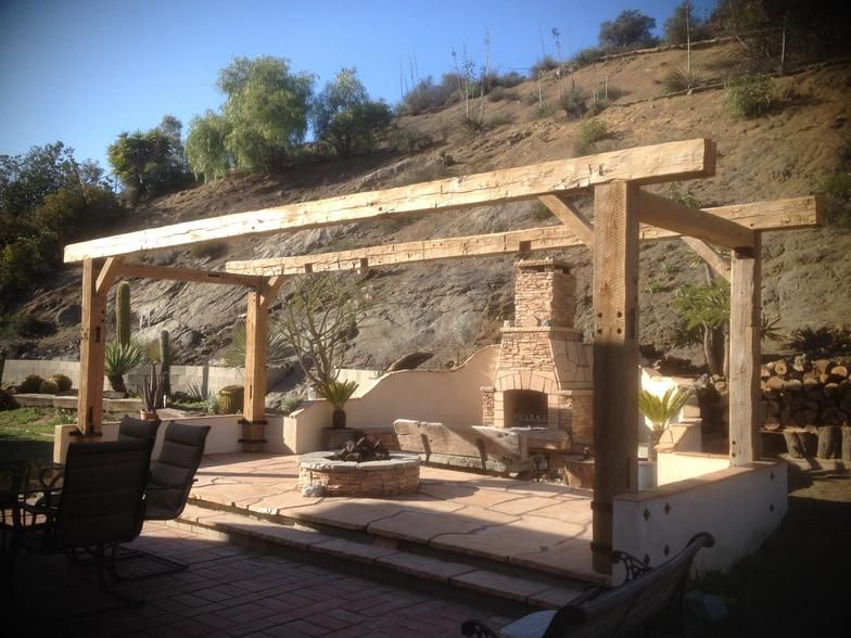 Reclaimed Barn wood beams make a stunning pergola Customer