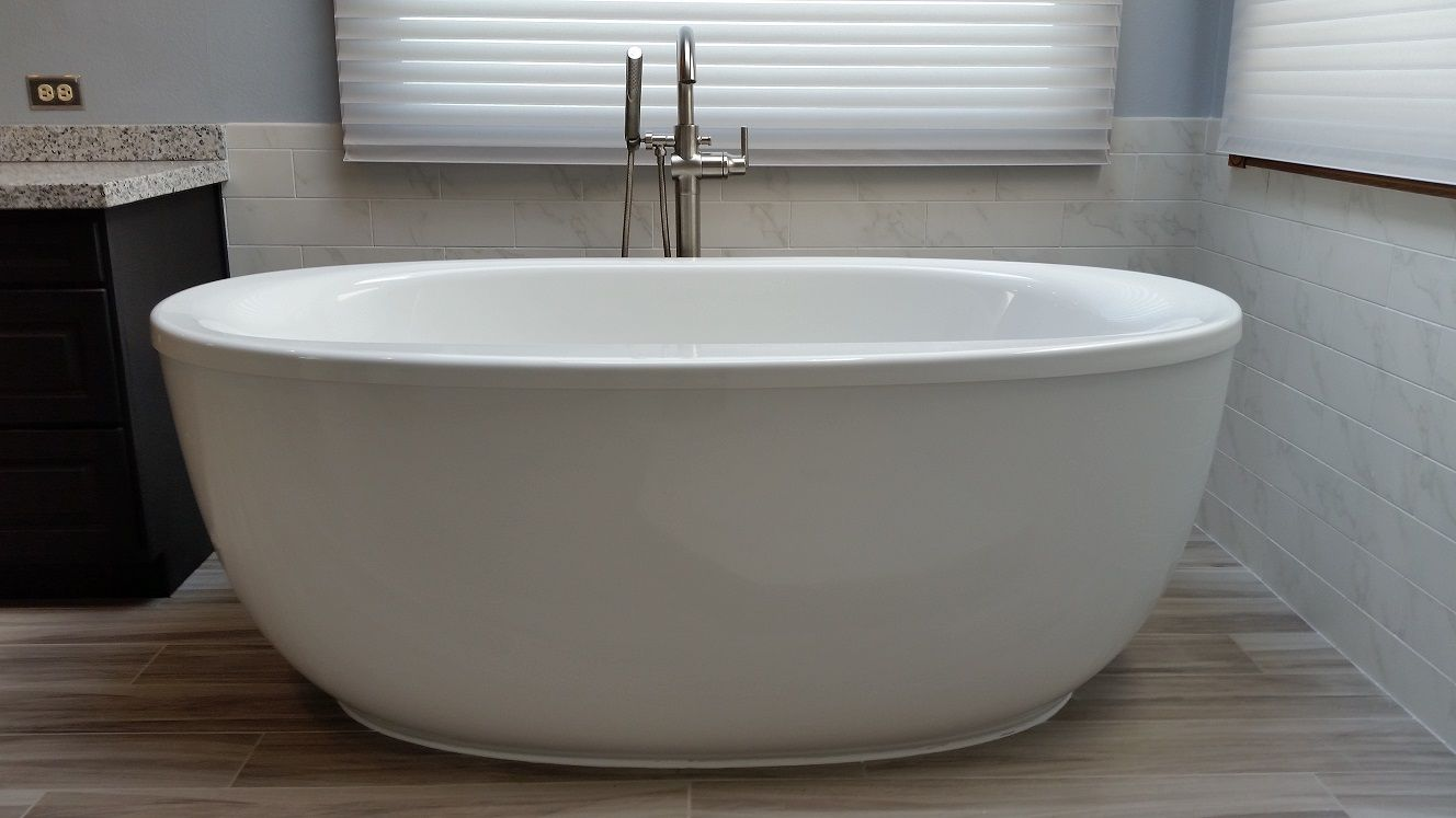 Kohler Sunstruck freestanding bath with fluted apron. This tub is in ...